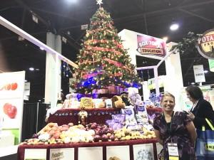 Rebekah Clark, Marketing Coordinator at Potandon Produce poses near Winter season tree display