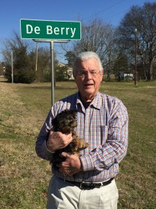 Dale DeBerry with new puppy, Savannah, traveling through DeBerry, TX